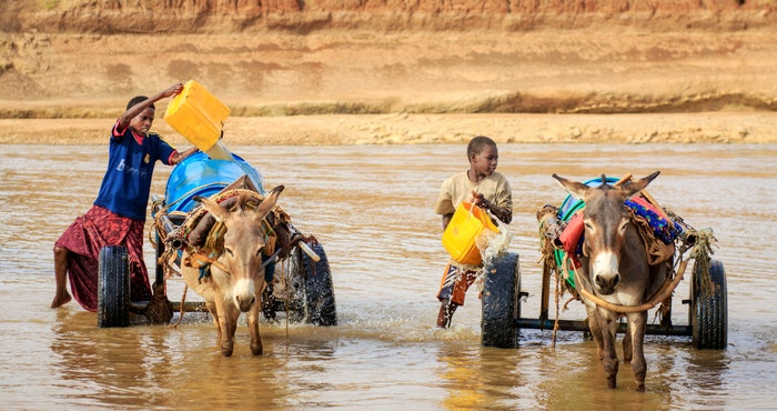 Young boys fetch water by UNICEF (Flickr)
