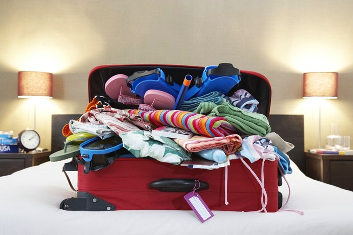 Open suitcase on bed