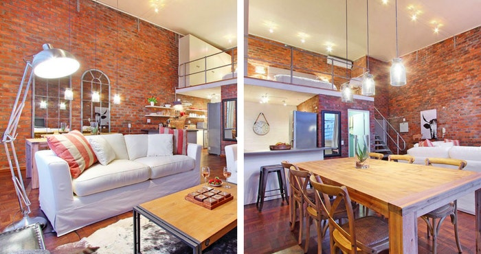 The industrial standing lamps add to the urban feel in the living room (left); The large wooden dining table adds a rustic twist (right) | Photos: TravelGround
