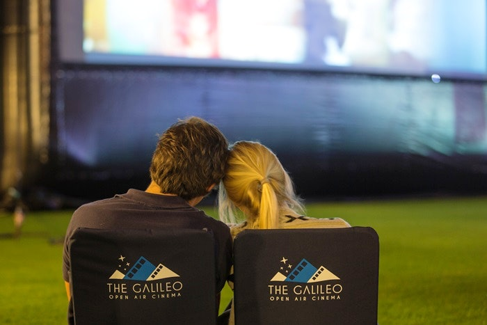 A couple enjoying a movie at the Galileo Open Air Cinema